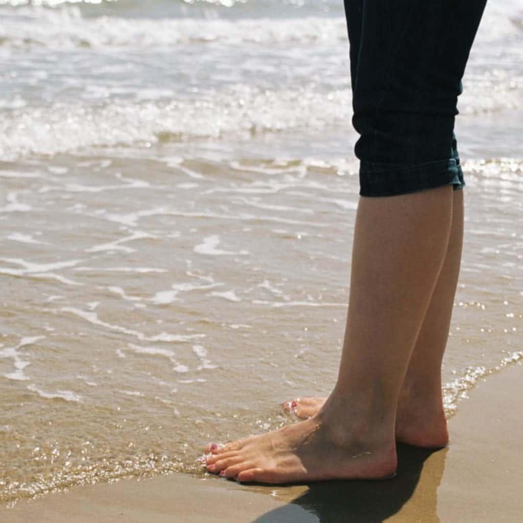 Feet by the beach