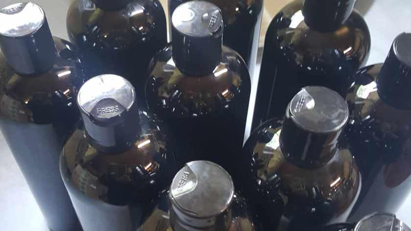 Shampoo Bottles Filled and waiting to be labeled.